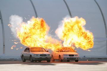 Vehicles explode during a security drill ahead of the 2018 Pyeongchang Winter Olympic Games in Pyeongchang