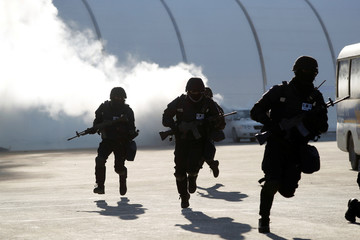 Police take part in a security drill ahead of the 2018 Pyeongchang Winter Olympic Games in Pyeongchang