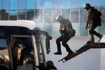SWAT take part in a security drill ahead of the 2018 Pyeongchang Winter Olympic Games in Pyeongchang