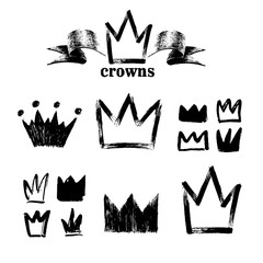 Big set of silhouettes of crowns. Black grunge icons. Painted by hand with a rough brush. Vector illustration. Isolated on white background