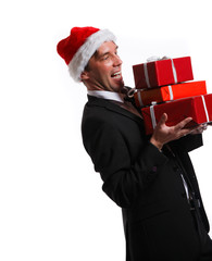 Photo of cheerful man in business suit, santa hat with gifts in boxes