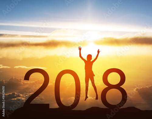 happy new year card 2018 silhouette of children girl jump on top of mountain with