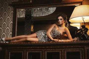 Beautiful woman wearing luxury shiny dress