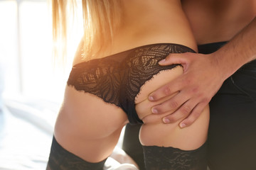 Male hand touching female butt. Sexy ass close up.
