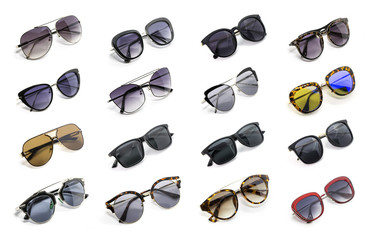 Group of beautiful sunglasses isolated on white background. Costume Fashion. Wall mural