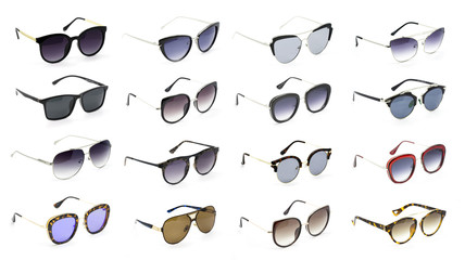 Group of beautiful sunglasses isolated on white background. Costume Fashion.