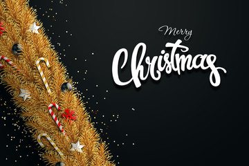 The inscription of a merry Christmas, golden branches of a Christmas tree with balls, candy, snowflakes and stars. Christmas background, greeting card. Happy New Year. View from above.