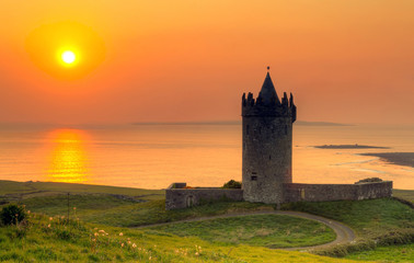 Aluminium Prints Castle Doonegore castle at sunset in Doolin, Ireland