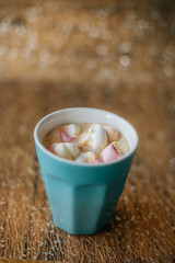 Coffee with marshmallow in a light blue cup