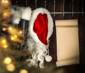 Santa Claus clothes and wooden wall