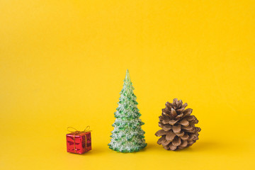 Christmas decorations on yellow background.