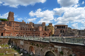 Rome Italy . August 15, 2014 at 13:00. Imperial holes, in the background tourists. Blue sky and soft white clouds.