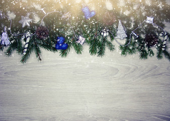 christmas decoration and snow on wooden background