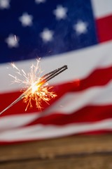 Canvas Prints Textures Sparklers burning against American flag background