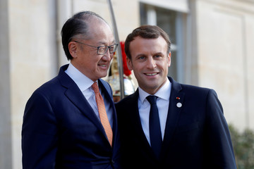French President Emmanuel Macron welcomes World Bank President Jim Yong Kim for a meeting at the Elysee Palace as part of the One Planet Summit in Paris