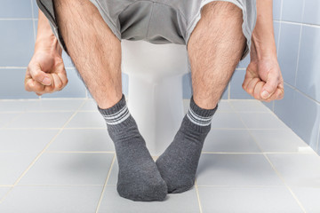Man sitting on toilet, diarrhea