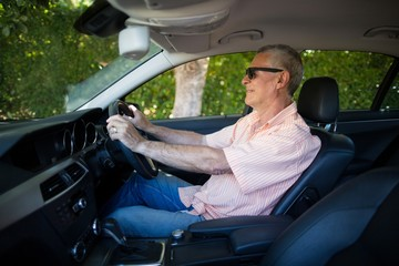 Senior man driving car