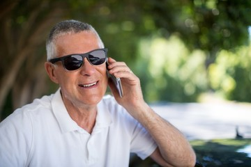 Happy senior man talking on phone
