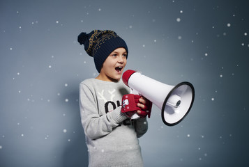 Happy child shouting into megaphone
