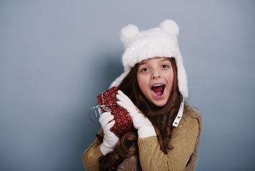 Surprised girl enjoying with christmas gift
