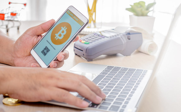 Man use smart phone pay with bitcoin