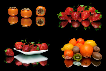 fresh juicy fruit and berries on a black background