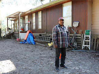 Alfredo Becerra, whose home was damaged by flooding during Hurricane Harvey, is pictured in Patton Village