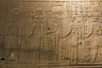Egyptian hieroglyphs and drawings on the walls and columns. Egyptian language, The life of ancient gods and people in hieroglyphics and drawings.