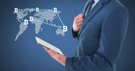 Bitcoin network on world map with businessman holding tablet