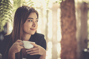 Young woman drinking coffee happily outside the office at lunch break. Relaxation, Coffee Break, Vintage style, Selected focus