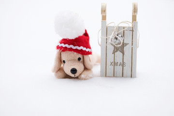 Small plush dog in Santa hat