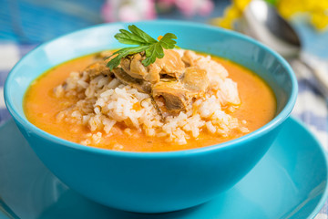Tomato soup with rice.