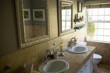 Mirror over sinks in bathroom