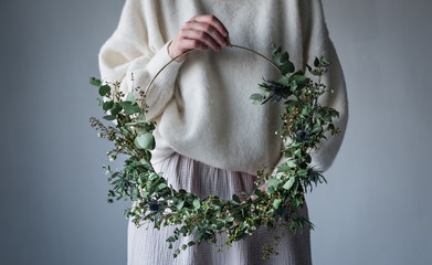 Midsection of woman holding wreath