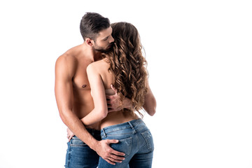 back view of beautiful sensual half naked couple in jeans isolated on white