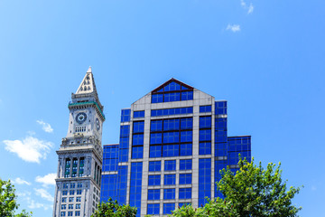 Classic Clock Tower by Blue Glass Office Tower