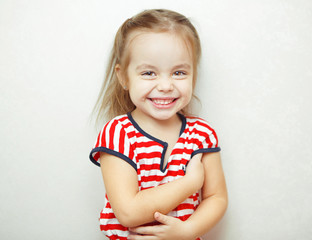 Little girl with broad sincere smile portrait photo