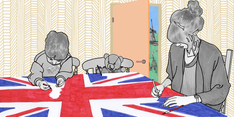 People colouring UK flag in room