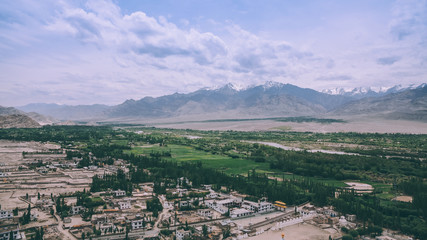 aerial view of Leh cityscape and beautiful mountains in Indian Himalayas