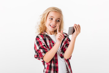 Portrait of an excited little girl playing games
