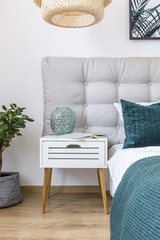 Simple bedroom with white nightstand