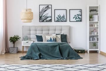 Rattan lamp in green bedroom