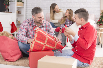 Father packing gifts for mother