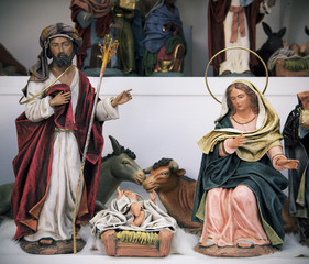 the holy family on sale in a Christmas market