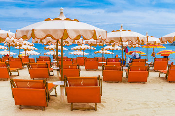 Wall Mural - Beach chairs and umbrella on the Fetovaia beach in Elba island, Tuscany, Italy.