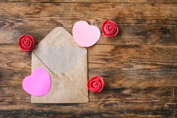 Valentine's day composition, envelope with blank note, heart shape sticker