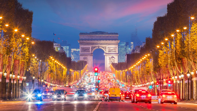 Famous Champs-Elysees and Arc de Triomphe at twilight in Paris