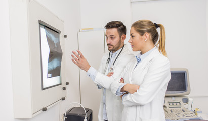 Doctors examining an x-ray of the patient