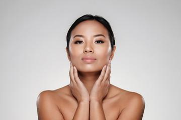 Beauty portrait of a pretty half naked asian woman