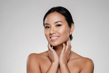 Beauty portrait of a happy half naked asian woman